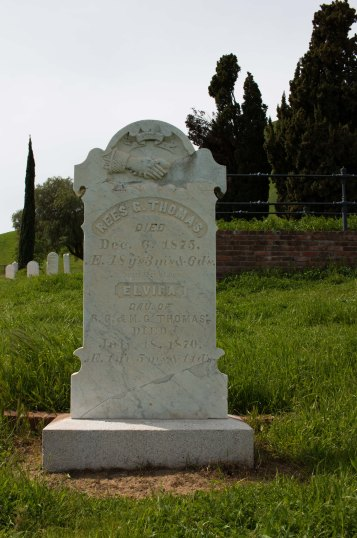"Rees Thomas, died 1875, age 48 (""We miss thee at home"") and his daughter Elvira, died 1870, age 1 year, 5 months."