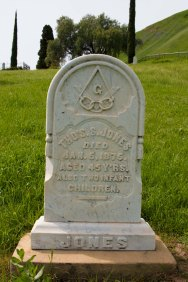 "Mason and Odd Fellow Thomas Jones, died 1875, age 45; buried with two infant children. (""Though lost to sight to memory dear"""