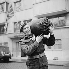 239px The four millionth British soldier to be demobilised Rifleman John Neale of the King s Royal Rifles leaves his unit in Brussels 9 February 1946 BU12271
